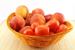 Basket of peaches and tomatoes Stock Image