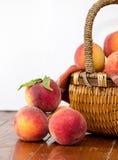 Basket of peaches on white Stock Image
