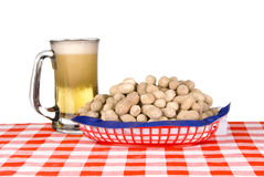 Basket of peanuts and mug of beer Stock Photos