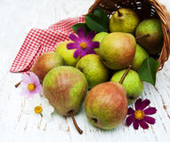 Basket with pears Stock Photos