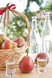 A basket with pears and pear schnapps Royalty Free Stock Image