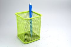 Basket and pen Royalty Free Stock Photos