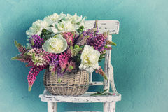Basket with peonies and lupins Royalty Free Stock Photography