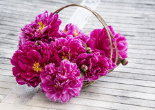 A basket with peony on a table Stock Images
