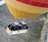 Basket of people hot air balloon from overhead Stock Photos