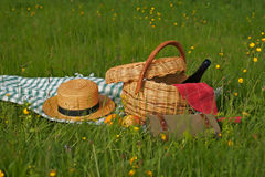 Basket of picnic. In grass posed on a tablecloth Stock Photo