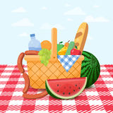 Basket for a picnic with fruit and various food. Stock Photography