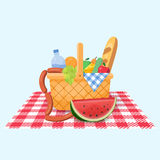 Basket for a picnic with fruit and various food. Royalty Free Stock Photography