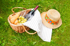 Basket for picnic with wine, croissants, grape Royalty Free Stock Photos
