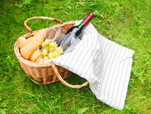 Basket for picnic with wine, croissants, grape Stock Images