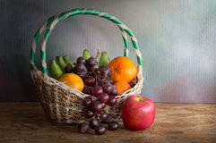 Basket with pile of fruits, Still Life Stock Image