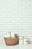 Basket with a pillow and milk cans Royalty Free Stock Photo