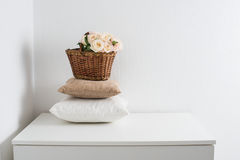 Basket and pillows Royalty Free Stock Images