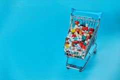 Basket of pills. Blue background. stock images