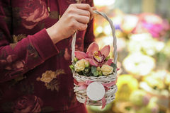 Basket with pink orchid flowers. Royalty Free Stock Photos