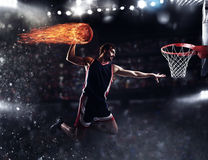 Basket player throws the fireball at the stadium Royalty Free Stock Images