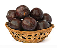 Basket of plums Royalty Free Stock Photos