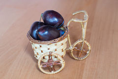 Basket with plums Royalty Free Stock Images