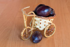 Basket with plums Stock Photography
