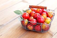 Basket of plums Stock Photo