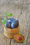 Basket with plums Royalty Free Stock Photos