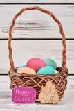 Basket and plywood rabbits cutout. Stock Photos