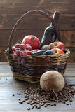 Basket with pomegranate and wine royalty free stock photo