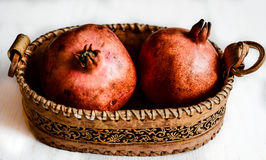 Basket with pomegranates Stock Photography