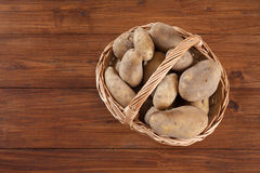 Basket with potatoes, copy space Stock Image