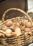 Basket of potatoes and eggs Royalty Free Stock Images
