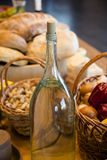 Basket of potatoes ready to be peeled with olive oil at hand royalty free stock image