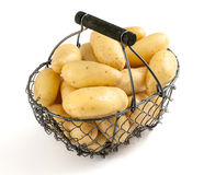 Basket of potatoes on a white background Stock Photo