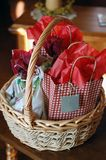 Basket of Presents. Wicker basket filled with presents Stock Image