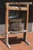 Basket press for winemaking. Old used vintage wooden basket press for winemaking Royalty Free Stock Image