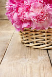 Basket of pretty pink peonies Stock Photo