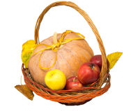 Basket with pumpkin and apples Royalty Free Stock Photo