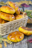 Basket with pumpkin buns. Stock Image