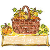 Basket with pumpkins Stock Images