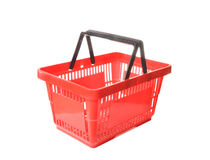 Basket for purchases. The red plastic basket costs on a table Royalty Free Stock Images