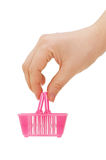 Basket for purchases in a female hand Royalty Free Stock Photos