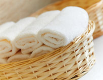 Basket of pure white towels Royalty Free Stock Images