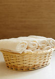 Basket of pure white towels Royalty Free Stock Image