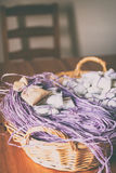 Basket with purple raffia, confetti and jute sachet Royalty Free Stock Photography