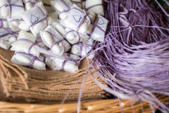 Basket with purple raffia and confetti Royalty Free Stock Photography