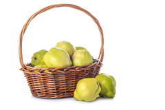 Basket with quinces isolated on white background. A basket with fresh quinces isolated on white background to make jelly and desserts in the kitchen Stock Photos