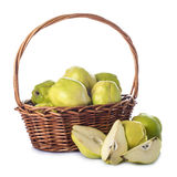 Basket with quinces isolated on white background Royalty Free Stock Photo