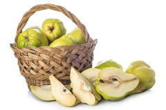 Basket with quinces  on white background Stock Photo