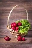 Basket with radishes Stock Photo