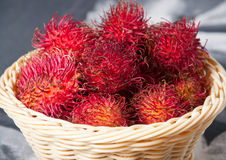 Basket of rambutan. It's a fruit that has the same texture of lychees, it is sweet and has a small seed inside just like lychees Royalty Free Stock Photography
