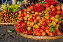 Basket with rambutan, Vietnam. Basket with rambutan at the street market, Vietnam Royalty Free Stock Images